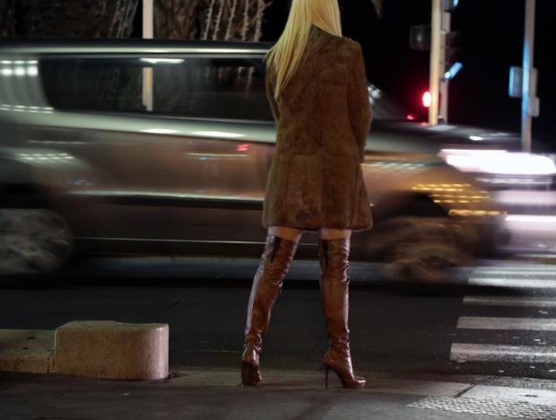 A prostitute from Eastern Europe waits for customers along the Promenade des Anglais in Nice, November 29, 2013. Eric Gaillard/Reuters